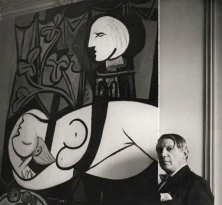 Pablo Picasso with his painting of Marie Thérèse Walter (1932 Nude, Green Leaves and Bust) by Cecil Beaton © Cecil Beaton Studio Archive, Sothebys London