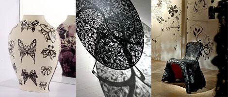 印象的な黒で描かれている透明のテーブルと蝶の花瓶