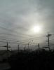 降灰でかすむ朝の太陽