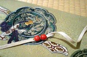 銅鏡の刺繍 綴れ帯