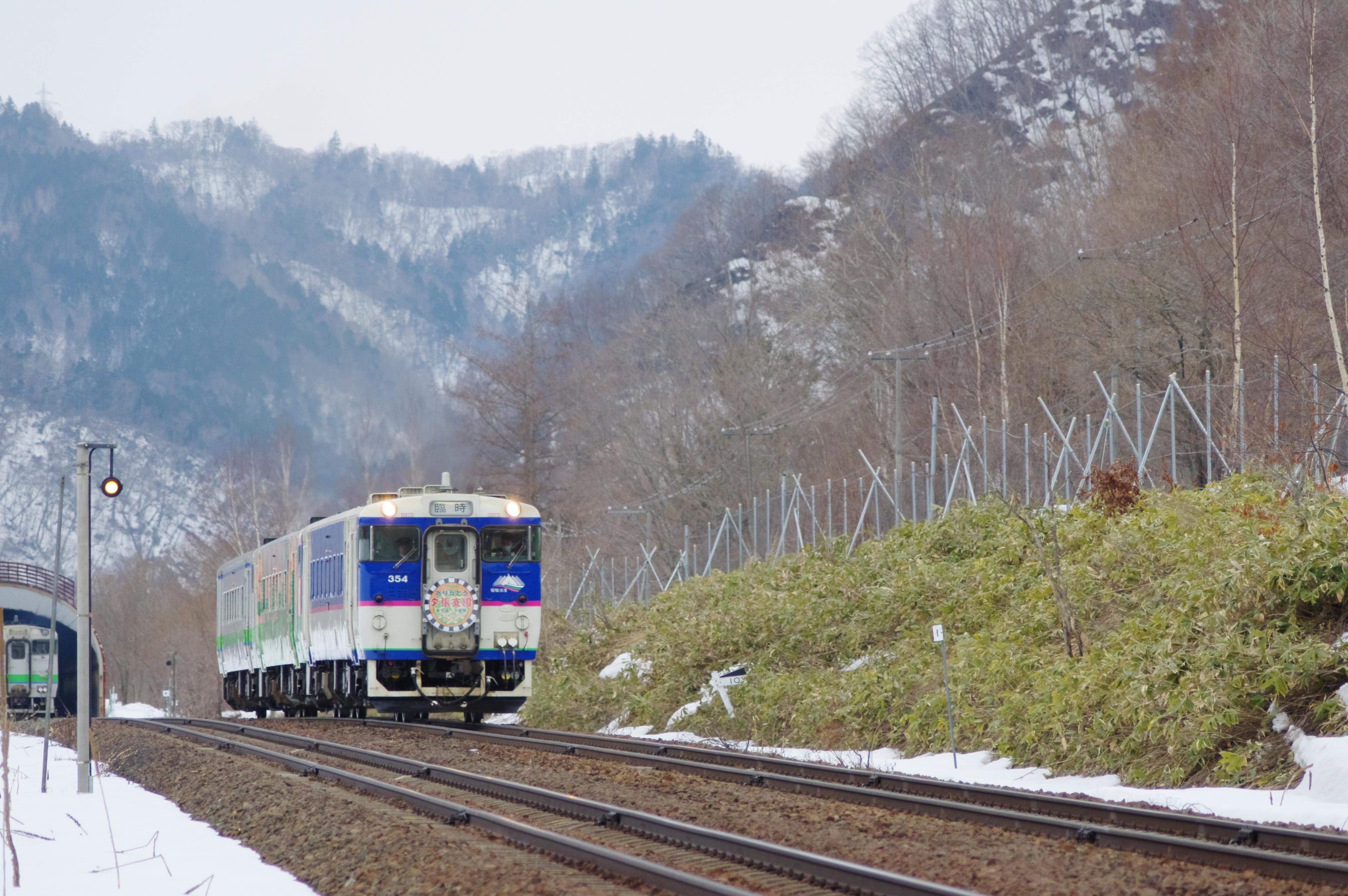 キハ40 9263D 送り込み回送 +2622D 列車交換 十三里信号場_190331 (4).jpg