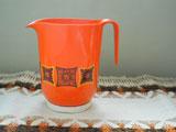 Kayser オレンジのプラスチックカップ