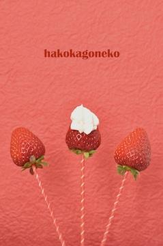 three strawberries with whipped cream