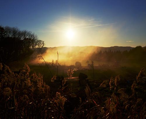 煙越しの午後の太陽