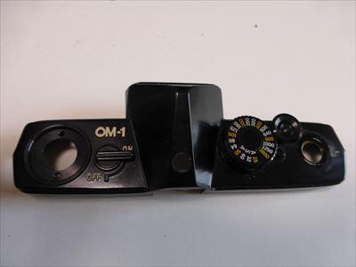 OM115