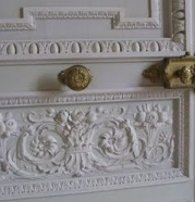Gilt fittings grace decorative double doors