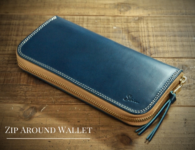 ブルーの革(ブッテーロ)の長財布(ラウンドファスナーウォレット)