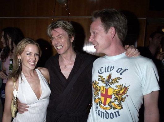 Minogue, Bowie and Cook in 2002.jpg