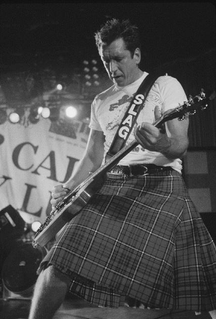 Steve Jones in Scottish Gents Kilt at 1996 Reunion Tour.jpg