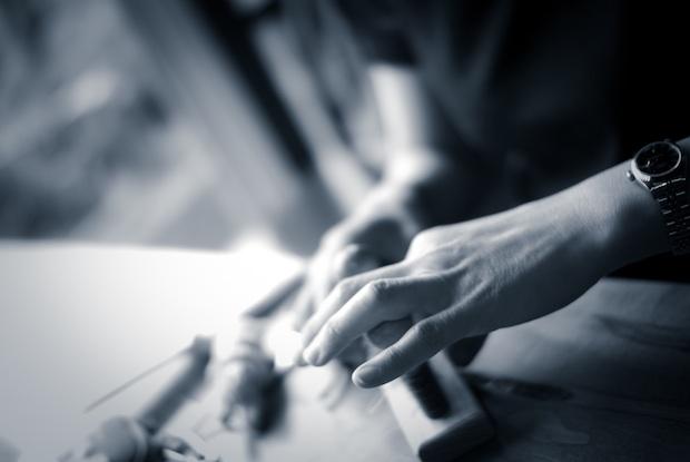 作る人の手