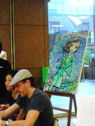 ジェフリーの後ろのキャンパスの画が先日行われたライブペンティング作品!