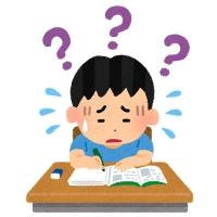 勉強に苦戦する男の子