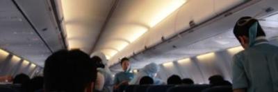飛行機内での体温検査