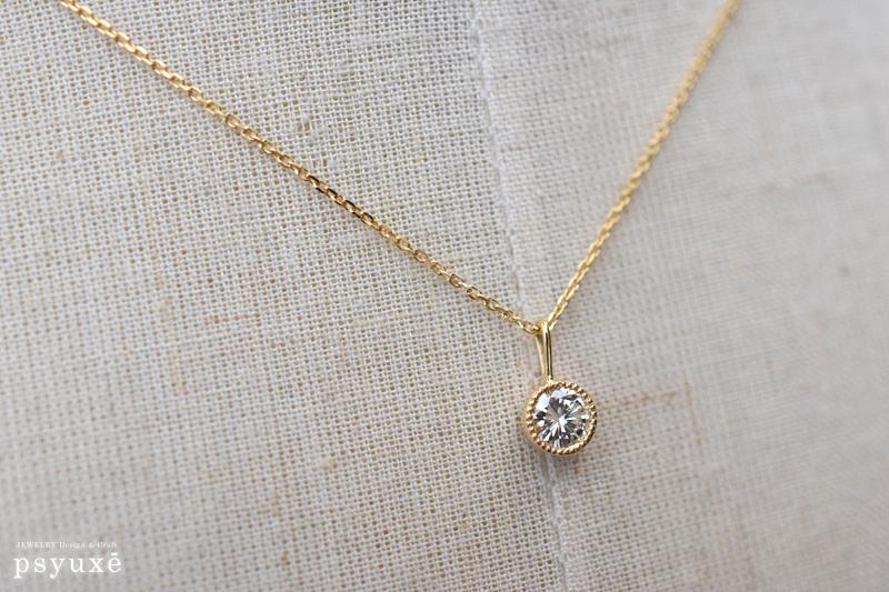 K18イエローゴールドとダイアモンドのミルグレインネックレス