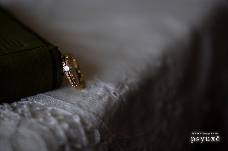 ダイアモンドとK18イエローゴールドのエンゲージリング