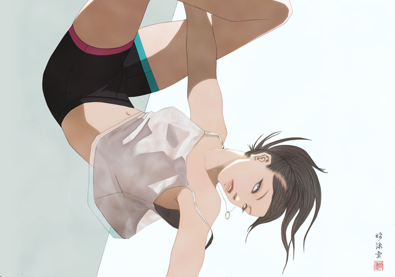 ボルダリングをする女性