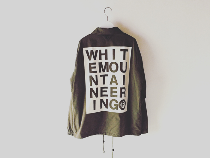 White Mountaineering/LOGO PRINTED COACH JACKET