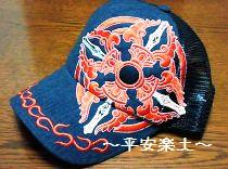 交差金剛杵デザインの帽子