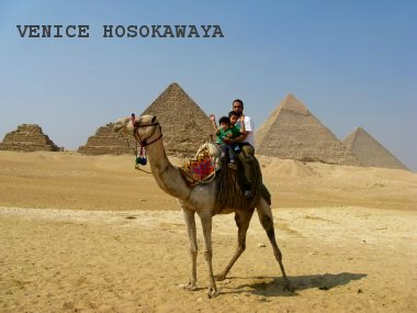 camel riding in front of pyramid