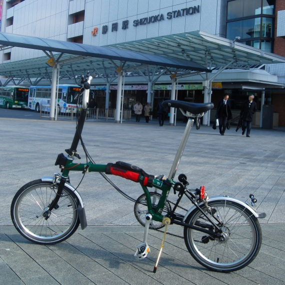 A brompton bike parked at the north wing of JR Shizuoka station