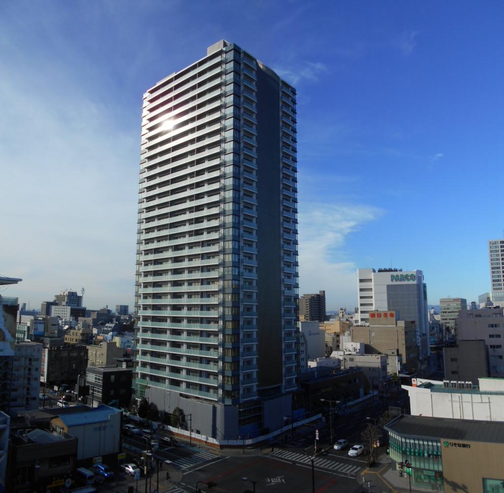 20181210_全景写真_現場北東側商業ビルより.jpg