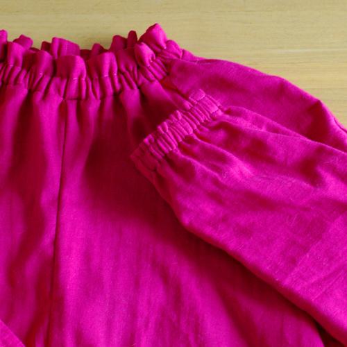 ピンクのブラウス