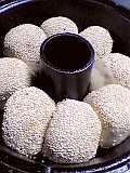 パン焼き器に並べ、二次発酵へ