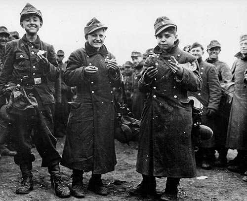 German_Youth_Soldiers_Captured_by_6th_Armored_Division_1945.jpg