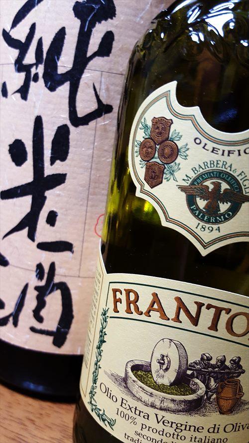 日本酒一升瓶とオリーブオイル500cc