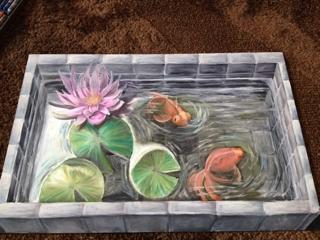 チョークアートで金魚の池と睡蓮の3D アート