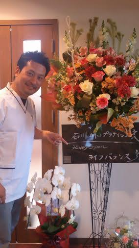 開業のお花と私