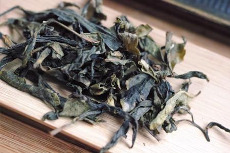 漫撒生態青餅2014年プーアル茶の黄片