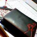 ホコモモラの財布