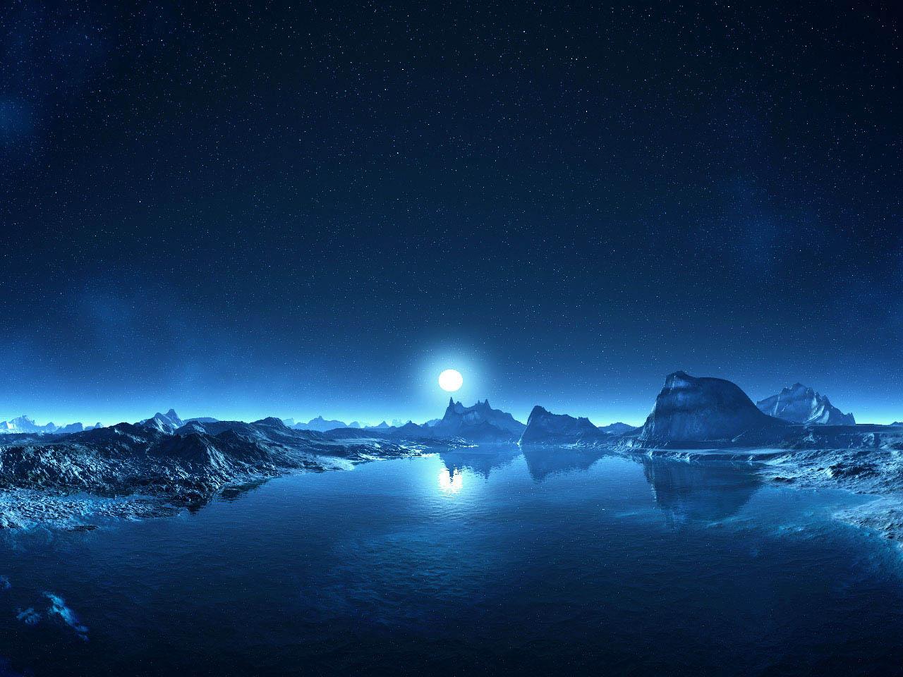 湖畔の岩場からのぞく月