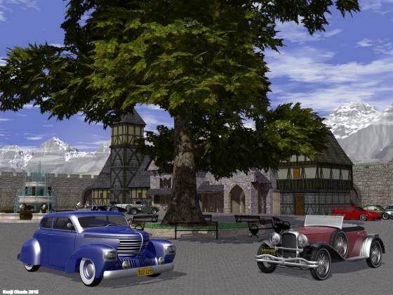 オークの巨木の下に駐車する2台のクラシックカー