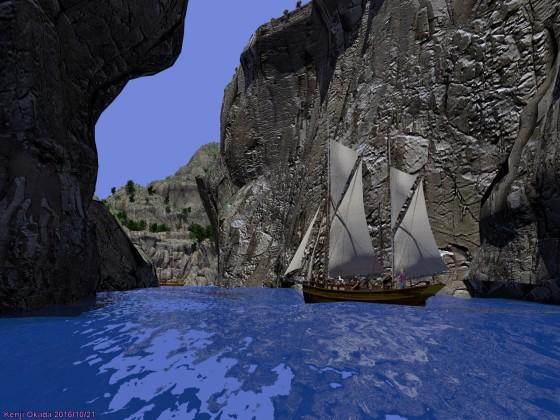 岩壁の隙間の水路を抜けて島の隠れ港に入ろうとするケッチ