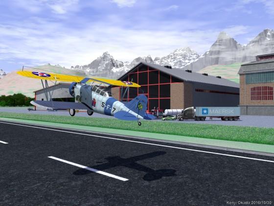 小型飛行場を飛び立つ複葉機Grumman FF-1