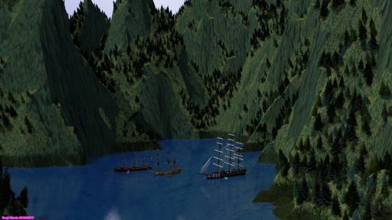 岩壁に囲まれた湾に錨泊する大型帆船