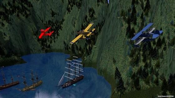 錨泊する大型帆船の上空を飛ぶ水上飛行機