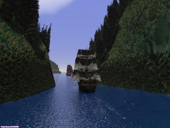 狭水路を抜ける大型帆船