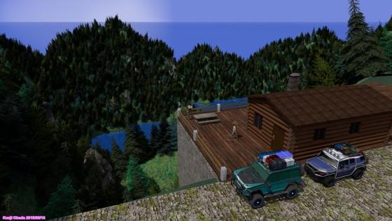 海を望む高台のログハウスとSUV