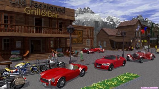 木造の建物の並ぶ通りと赤いオープンカー