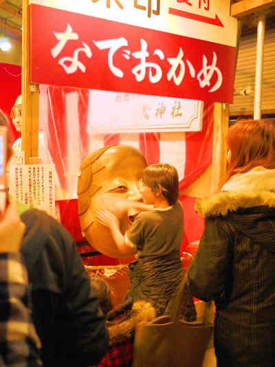 浅草・鷲(おおとり)神社の酉の市のなでおかめの画像