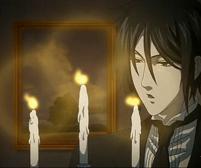 蝋燭の灯を吹き消すセバスチャン