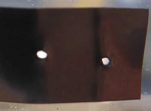 引きはがしたニッケル版、溶接棒先端を丸くすればナゲット跡がもう少し大きくなるかな
