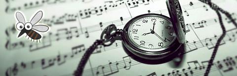 楽譜と時計の写真