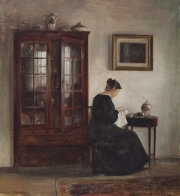 INTERIOR WITH A WOMAN AT HER NEEDLEWORK