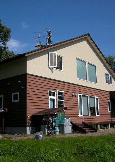 屋根の上の煙突掃除