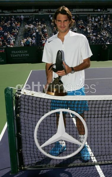 INDIAN WELLS, CA - MARCH 20: Roger Federer of Switzerland poses with the trophy after defeating Lleyton Hewitt of Australia in the championship final of the Pacific Life Open at the Indian Wells Tennis Garden on March 20, 2005 in Indian Wells, California. Federer won 6-2, 6-4, 6-4. (Photo by Matthew Stockman/Getty Images)