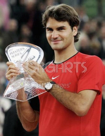 HAMBURG, GERMANY - MAY 15: Roger Federer of Switzerland celebrates winning his match against Richard Gasquet of France during the final of the Masters Series Hamburg at Rothenbaum on May 15, 2005 in Hamburg, Germany. (Photo by Alexander Hassenstein/Bongarts/Getty Images)
